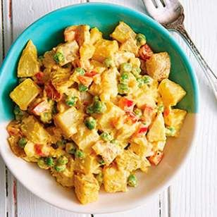 In this healthy and creamy potato salad recipe, yogurt replaces half of the mayo and we keep the potato skins on for more fiber and potassium.