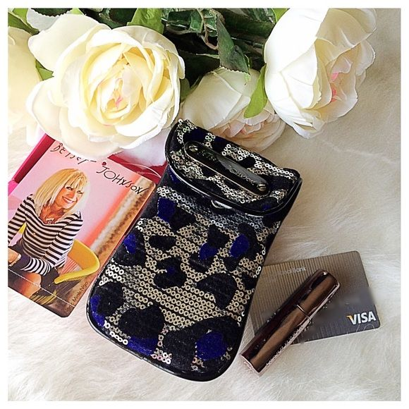 """Betsey Johnson Cheetah-Licious PDA Case Sequined shimmer in silver and dark blue. This PDA case is large enough to hold an iPhone 6, and measures at just over 3.5"""" across the bottom and 5.25"""" in length. Carry your phone in style. Versatile, could also be used to carry your cash, lipstick etc for those nights when you want to simplify. Brand new, will be shipped in box. Matching zip top clutch also for sale. Betsey Johnson Accessories Phone Cases"""
