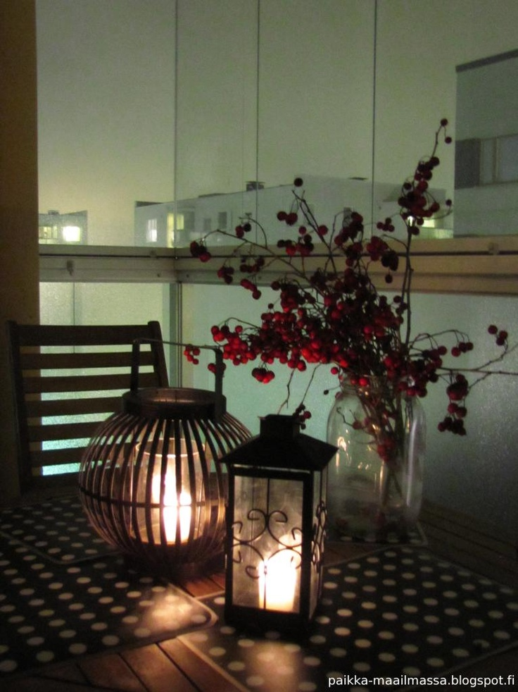 Balcony in the winter: Lanterns and hawthorn braches