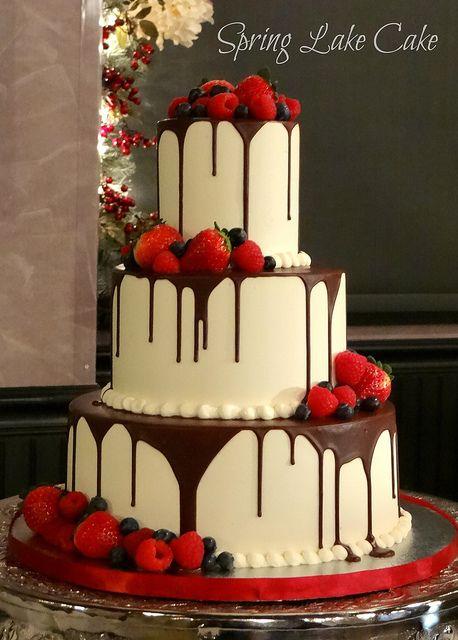 White Chocolate Cake w/ Dark Chocolate Drizzle & Berries