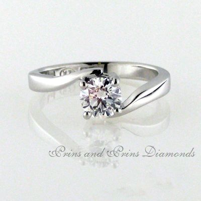 A little twist gives this diamond ring a lot of appeal.
