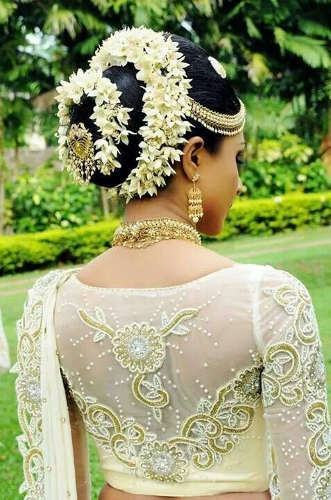 South Indian bride. Temple jewelry. Jhumkis.White silk sari.Bun with fresh flowers. Tamil bride. Telugu bride. Kannada bride. Hindu bride. Malayalee bride.Kerala bride. Sinhalese bride.