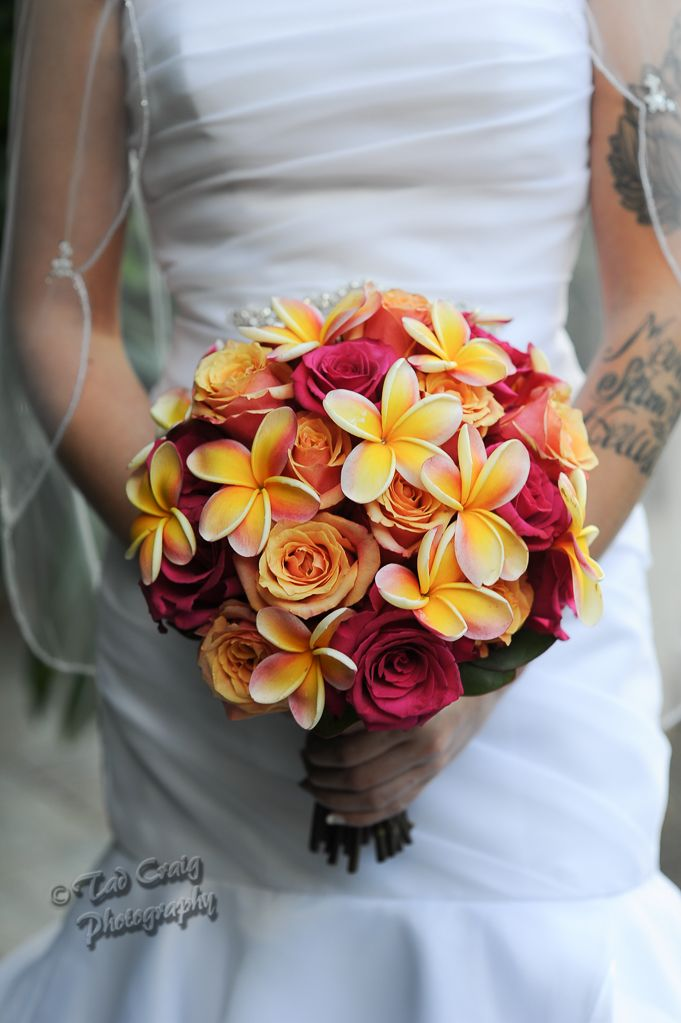 Plumeria and Roses~ Very tropical colors. Plumeria and Rose Bouquets. Maui Wedding Photography. Photo by www.TadCraigPhotography.com