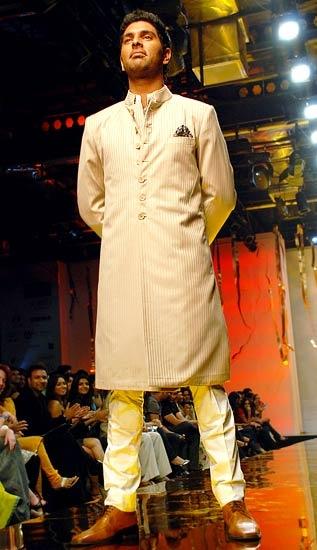 Knee length bandhgala kurta with churidaar by Designer Raghuvendra Rathore