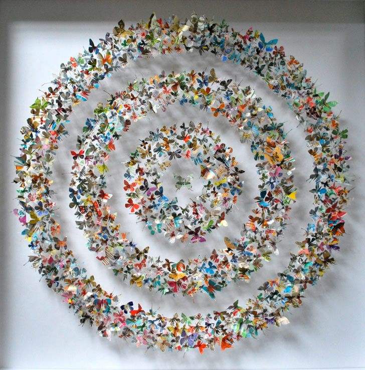 Artist Rebecca J. Coles ReUses paper in cutouts of butterflies