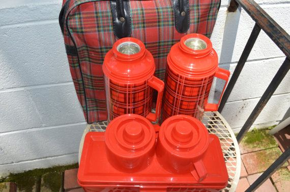 Scotch plaid Aladdin thermos picnic, camping set. Aladdin Industries, Inc. Nashville, Tenn. USA. This is a vintage 1960s, pre-owned set. The carrying bag shows tiny white paint spots mainly on the top and some fading on the surface. Aside from that, the thermoses and plastic lunch box