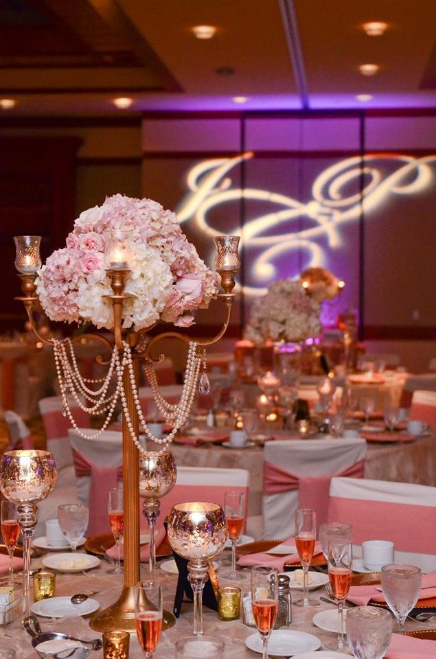 Vintage Center piece-pink and white hydrangea and roses on gold candleabra with drapped pearls and votive candles.