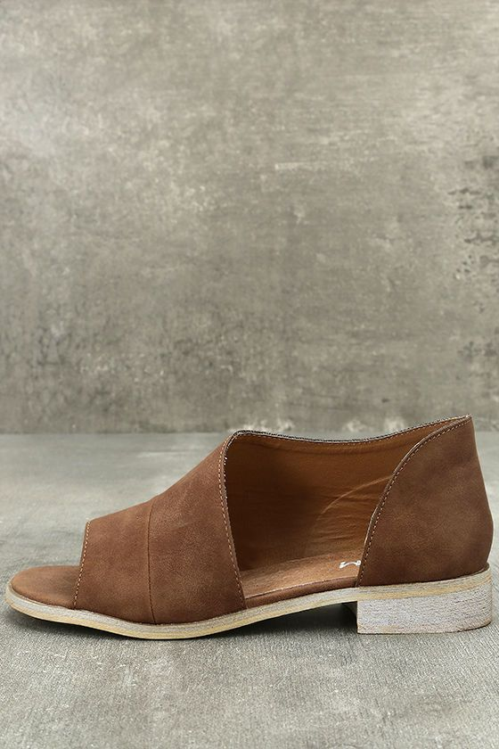 The Shania Brown D'Orsay Peep-Toe Flats are effortlessly cool! Vegan leather sweeps into a unqiue split upper from a peep toe. Structured heel cup.