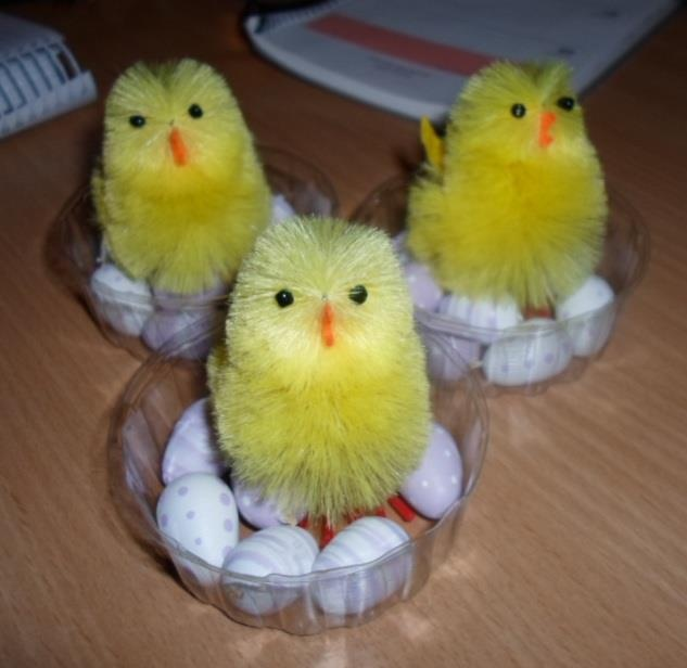 A decoration with chickens on easter eggs.