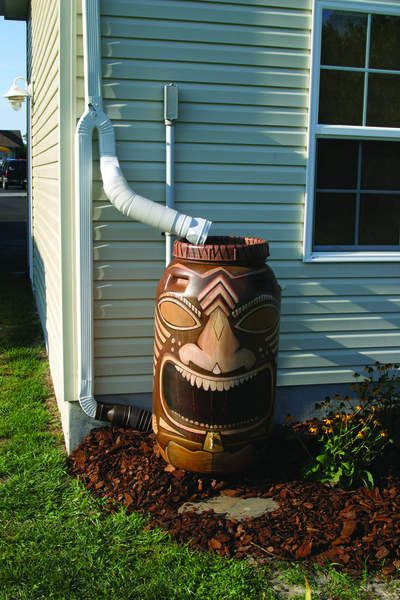 painted rain barrels | This totem-style rain barrel features a spigot which can be connected ...