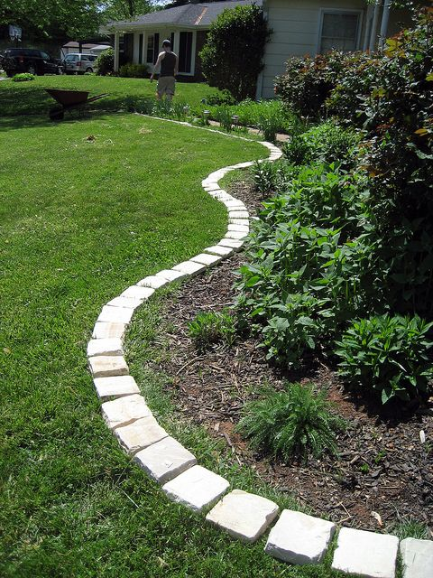 Brush polymeric paver sand between the cracks of the stones. Do not use regular sand for this step. Polymeric paver sand hardens when wet. This prevents weeds from growing between the stones and keeps the stones in place.