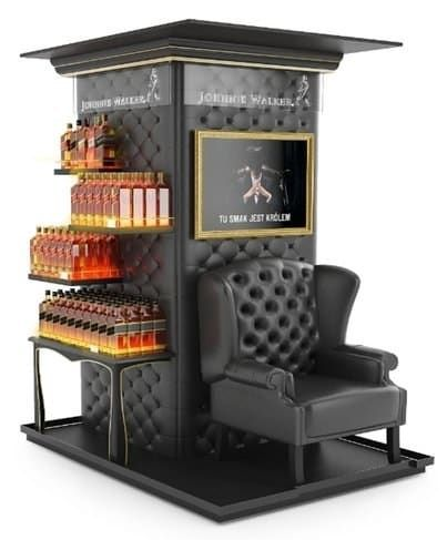 """""""Tu Smax jest krum"""" which roughly translates to """"The King is here"""" The unit was designed to bring the two worlds of Johnnie Walker and Bushmills together in one well-executed, creative display. It's also got a bar and a chair….making it my kind of pop-up display!"""