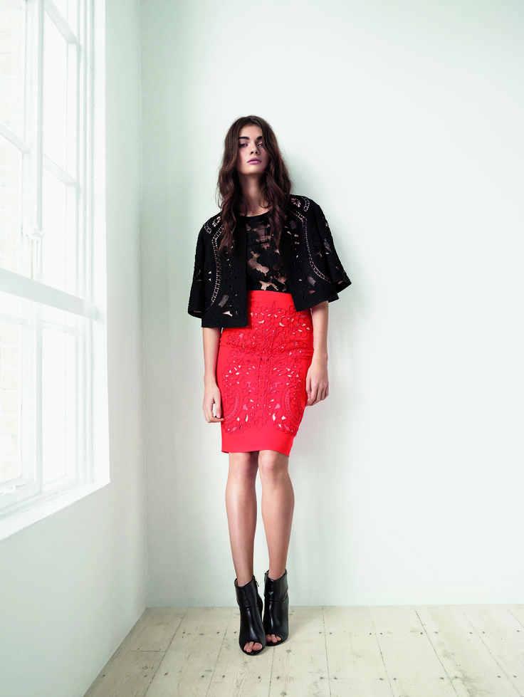 Different textures clash in this sharp boxy jacket and pencil skirt pairing.