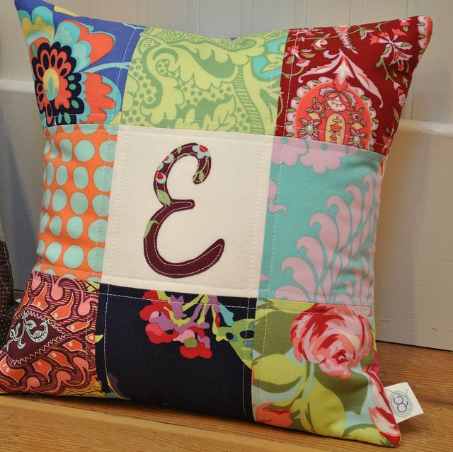 Quilted block pillow---i love this and can think of so many fabrics i would love to have one of these in!! do i know any quilting friends?? :)
