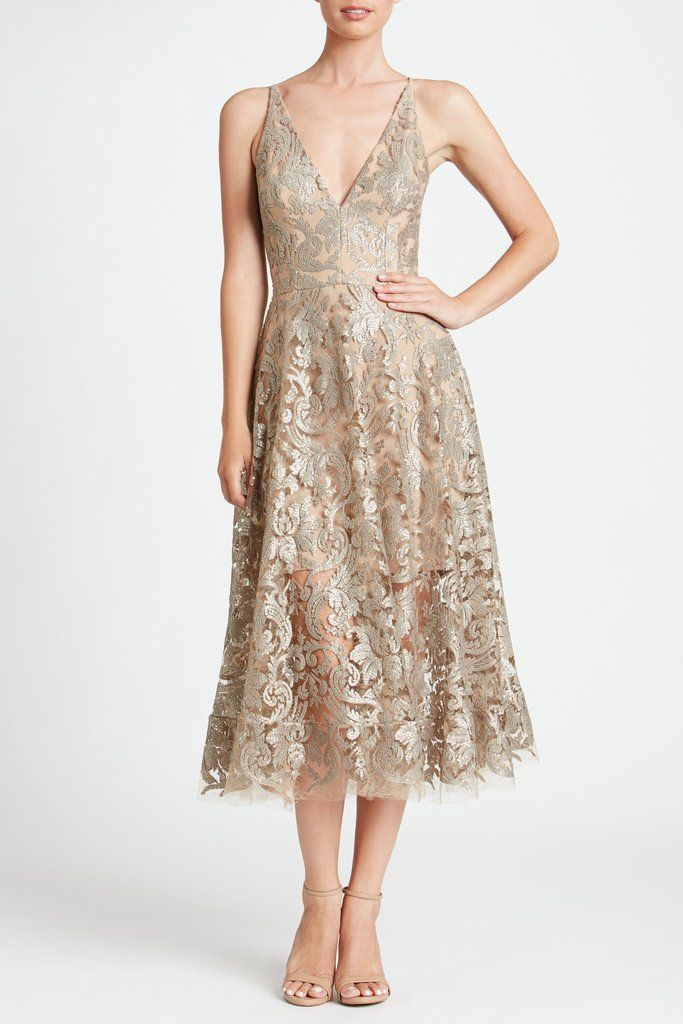 e8f51fed3088b The Platinum Blair Sequin Lace Fit-and-Flare Midi Dress gets a chic update  with a flattering deep v-neck, sequin embellishments and raw-edge hem.  Approx.