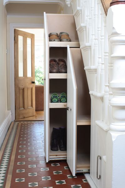10 Ways to Use Space Under the Stairs  Pull out under the stair storage. Vertical pull out lockers are genius! look at all of that storage space for coats, shoes, and sports equipment. & they look beautiful when they are closed to. No mess in the open anymore!