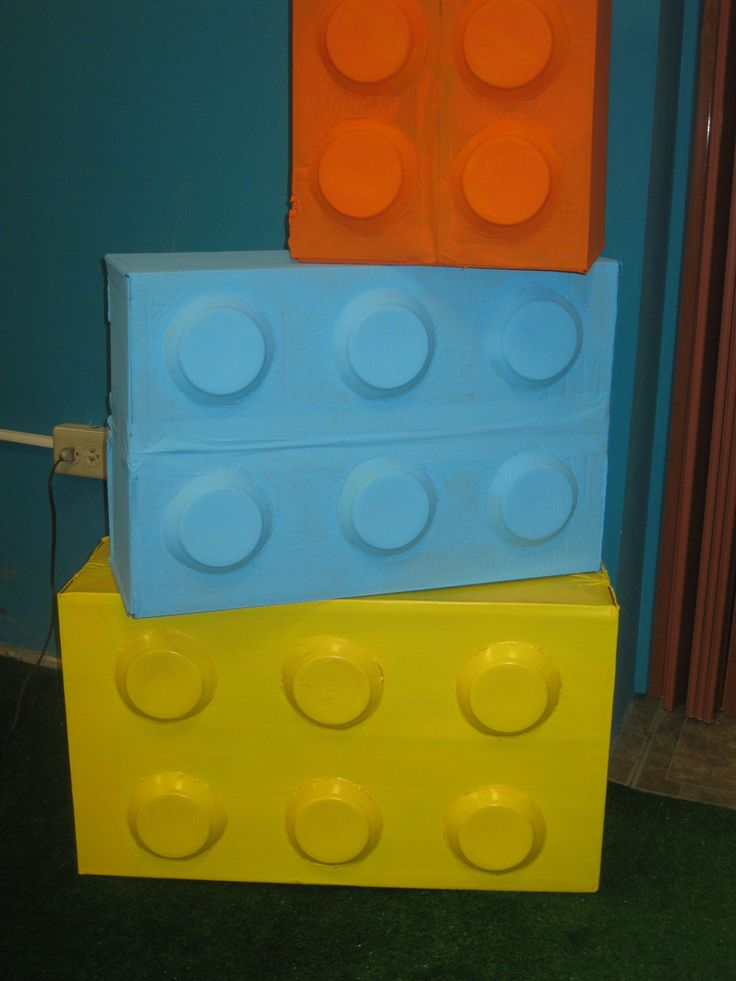 Decorate boxes to create large-scale LEGOs - use them party decor or photo booth props