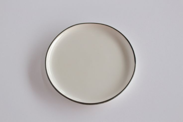 "The pure white is highlighted by the simple beauty of a single blue line, hand painted on the rim. Microwave and dishwasher safe. 5"" in diameter"