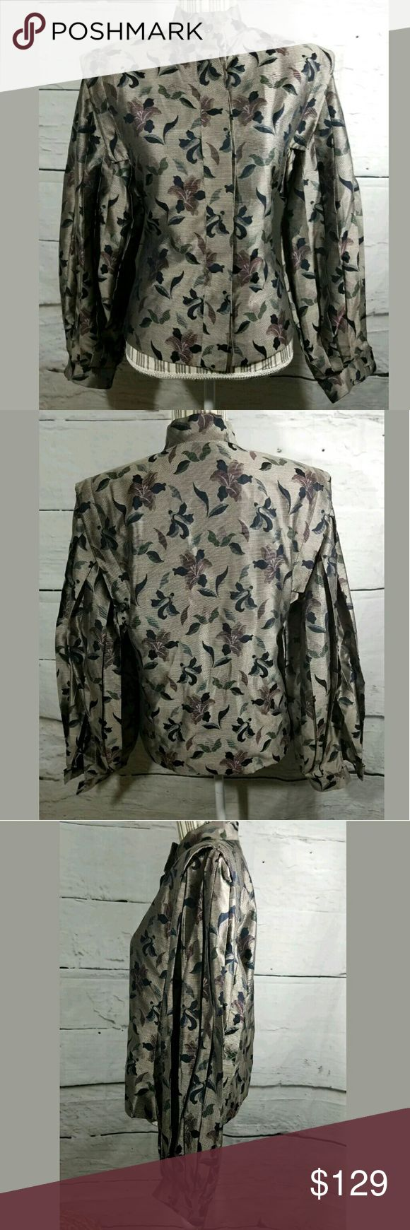 Salvatore Ferragamo Long Balloon Sleeve Silk Top Salvatore Ferragamo Long Balloon Sleeve 100% Silk Couture Floral Blouse   Excellent used condition. No holes or stains. Minor snags/pulls that are not very noticeable.  Lightly padded shoulders. Gorgeous pleated sleeves.   19 inches pit to pit.  24 inches long.   LB Salvatore Ferragamo Tops Blouses