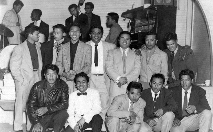 #4 2nd Generation: Bridge Generation young men posing at a wedding reception in Livingston in 1954.  Note the band members on break in the background, also BG contemporaries, who provided swing/jazz music for dancing. (Photo courtesy of Peter Jamero)