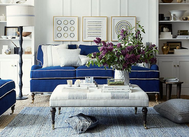 LOVE THIS - INSPIRATION FOR LIVING ROOM.   Love the fabric on the ottoman, love the contrasting piping and blue fabric.