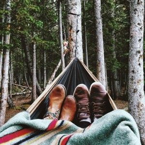 Couple lying in a hammock in the woods