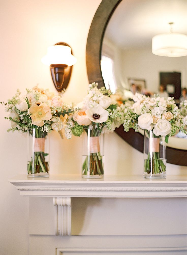 ask your florist to provide vases for the bouquets, so they stay fresh and add some extra pretty to an empty corner or your top table