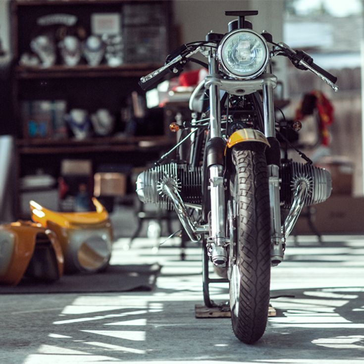 We're huge fans of the auto site StanceWorks. Main man Mike Burroughs has now pointed his lens at motorcycles, and chosen the perfect subject: ace restorer Brandon Mungai of Bavarian Cafe. Enjoy.