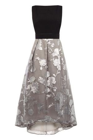 This beautiful dress is a true show stopper. The Roccobella Dress features a catwalk inspired skirt with statement volume. The subtle pleats at the waist create a modern look whilst the tulle under skirt creates exaggerated fullness and dramatic flaring. The vibrant luxe pattern on the skirt adds a modern touch, whilst the waist band secures with two popper buttons for the perfect fit. Finishing with a concealed back zip this piece measures 51 inches/129cm from side neck point to hem…