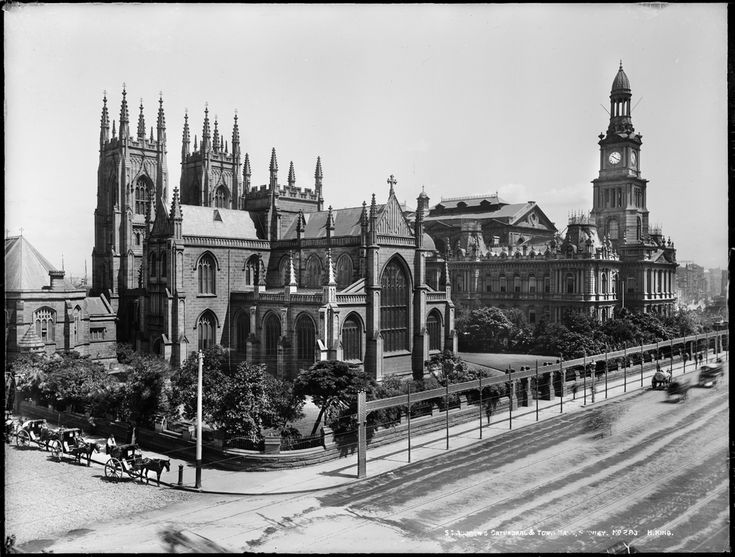 Sydney Town Hall, on George Street, as it appeared in the early 1900s with St. Andrew's Cathedral to the left.