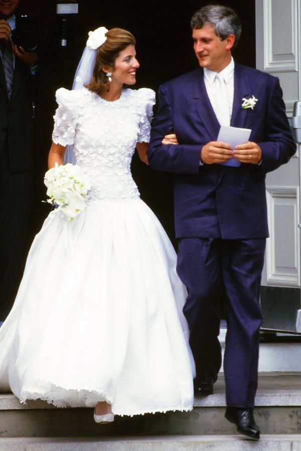 Caroline Kennedy - The Most Iconic Wedding Dresses of All Time - Southernliving. Wed Edwin Schlossberg in July 1986  The dress was designed by Carolina Herrera, a favorite designer of Caroline's mother, Jackie. The silk organza gown had a drop waist, high round neck, and short sleeves.