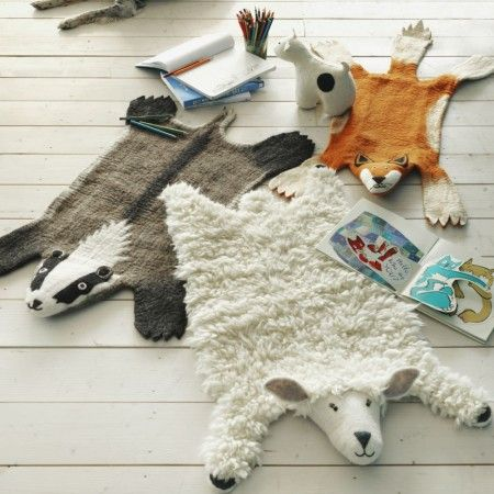 Animal Felt Rugs  (someone should make these as floor cushions, to resemble resting animals rather than taxidermied hides.)