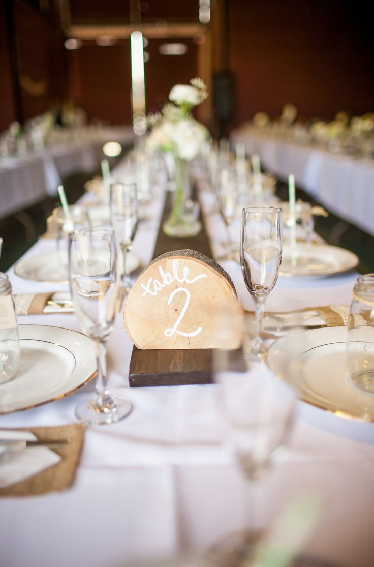 The wooden slices make the perfect table numbers! View the full wedding here: http://thedailywedding.com/2015/12/31/glowing-orange-grove-wedding-crista-cody/