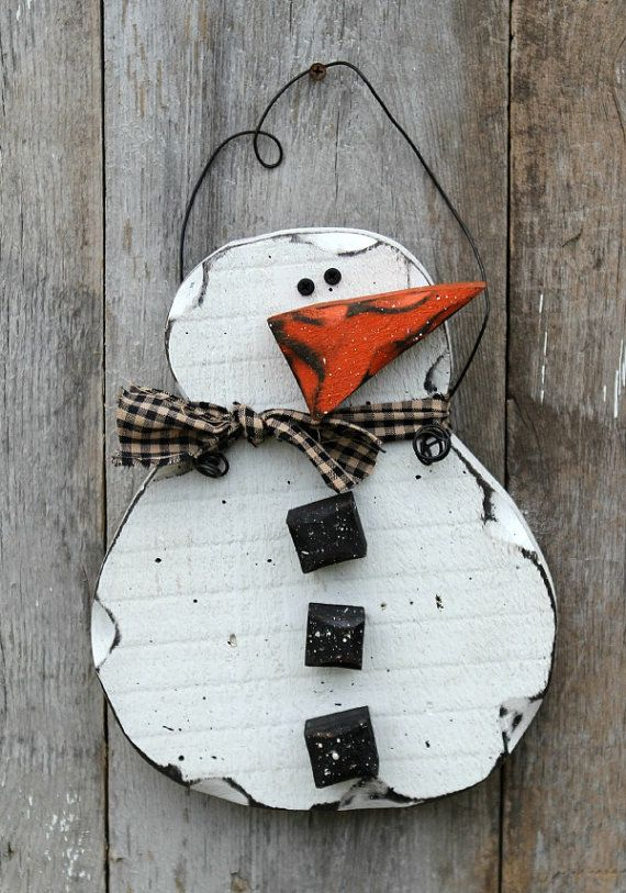 primitive wood snowman-They are made of 1 inch thick rough cut pine (body, buttons, nose). He measures 10 3/4 inches 8 1/2 inches. He is painted, sanded, specked, and stained for a rustic/primitive look. at Etsy