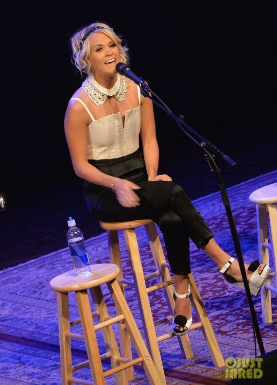 Carrie Underwood wearing Alice + Olivia Arrow Two-Tone Jumpsuit in White/Black. Carrie Underwood fan club party in Nashville June 4 2013.