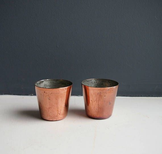 Check out this item in my Etsy shop https://www.etsy.com/uk/listing/520037004/2-small-vintage-round-copper-cake-moulds