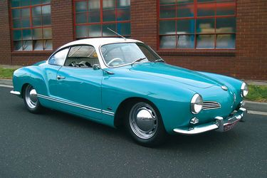 1961 Karman Ghia. My first car was a yellow Karman Ghia convertible. Loved it! Someday I will get one just like it again, although this blue is pretty.... :)