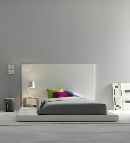 Minimalistic bedroom design Grey walls stand in contrast to the