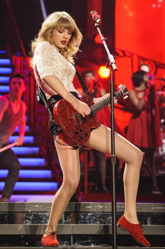 "Taylor Swift rocks out during her performance at the Prudential Center during ""The Red Tour."""