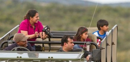 Guide Darlington with a family on a private game drive at River Bend Lodge, Addo, South Africa.