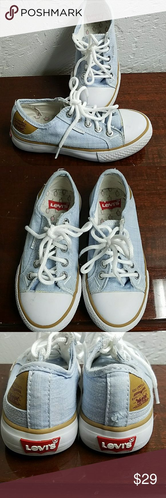 Levi's Converse style shoes Excellent used condition! One small tear at the bottom of the right shoe as shown in the photo, otherwise these shoes are in perfect condition! Levi's Shoes Sneakers