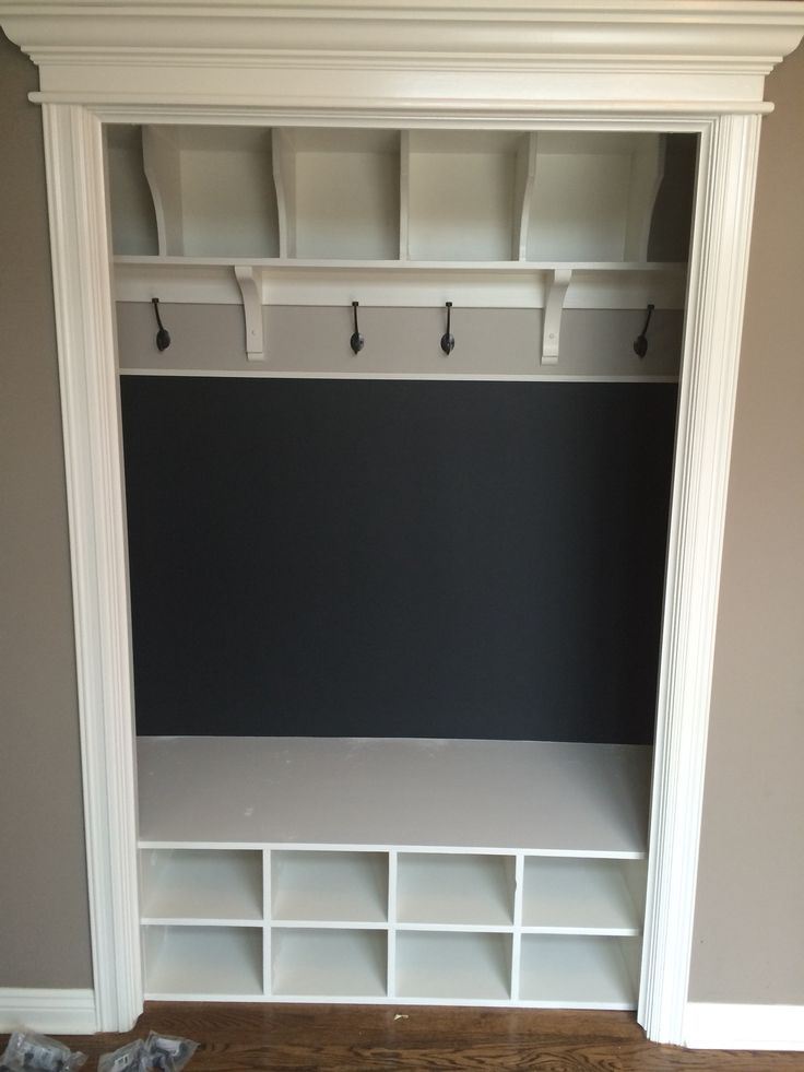 Entry closet converted to lockers with chalkboard paint