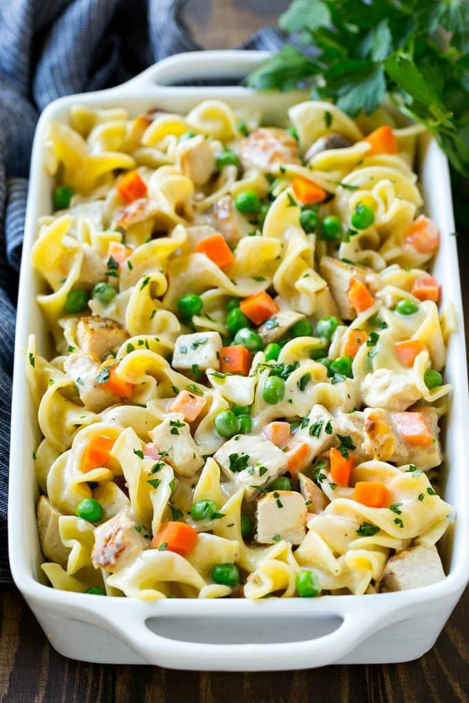 This easy chicken noodle casserole is a complete meal in one pan with chicken, veggies and egg noodles all together in a creamy sauce!