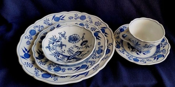 "Blue Onion-Scalloped-Rim Four Piece Place Setting by Hutschenreuther. Dinner plate10"", salad plate,7 1/2"",small bow and cup and saucer. The bowls/saucers measures 4"" across and are 1 1/2"" tall. There is no indent. 