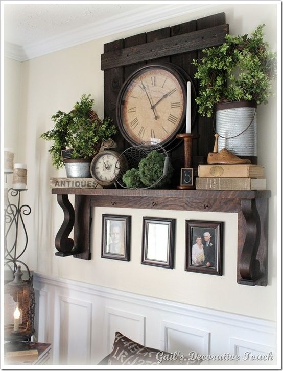 Cream wall, white trim, dark wood and greenery! Add some vintage collectables and you have a beautiful living room focal point