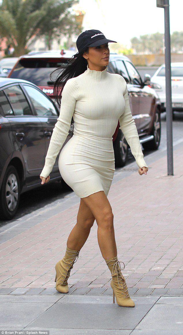 Kim Kardashian shows off her shapely rear in a white dress #dailymail