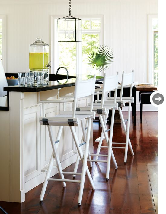 A rustic bar in the white kitchen Drinks Table