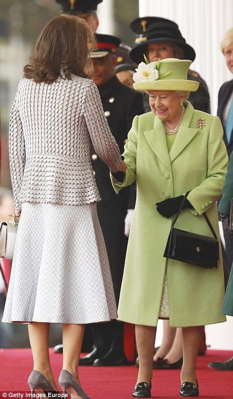 The Queen greets Maria Clemencia de Santos at the ceremonial welcome for her and her husband President Juan Manuel Santos