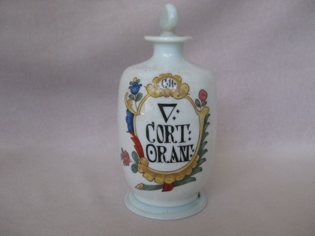 A rare German  milk glass apothecary bottle bearing the nicely painted label for  aq.Cort. Orant within a decorative cartouche. Glass stopper.  German  C 18 th   Height 8""