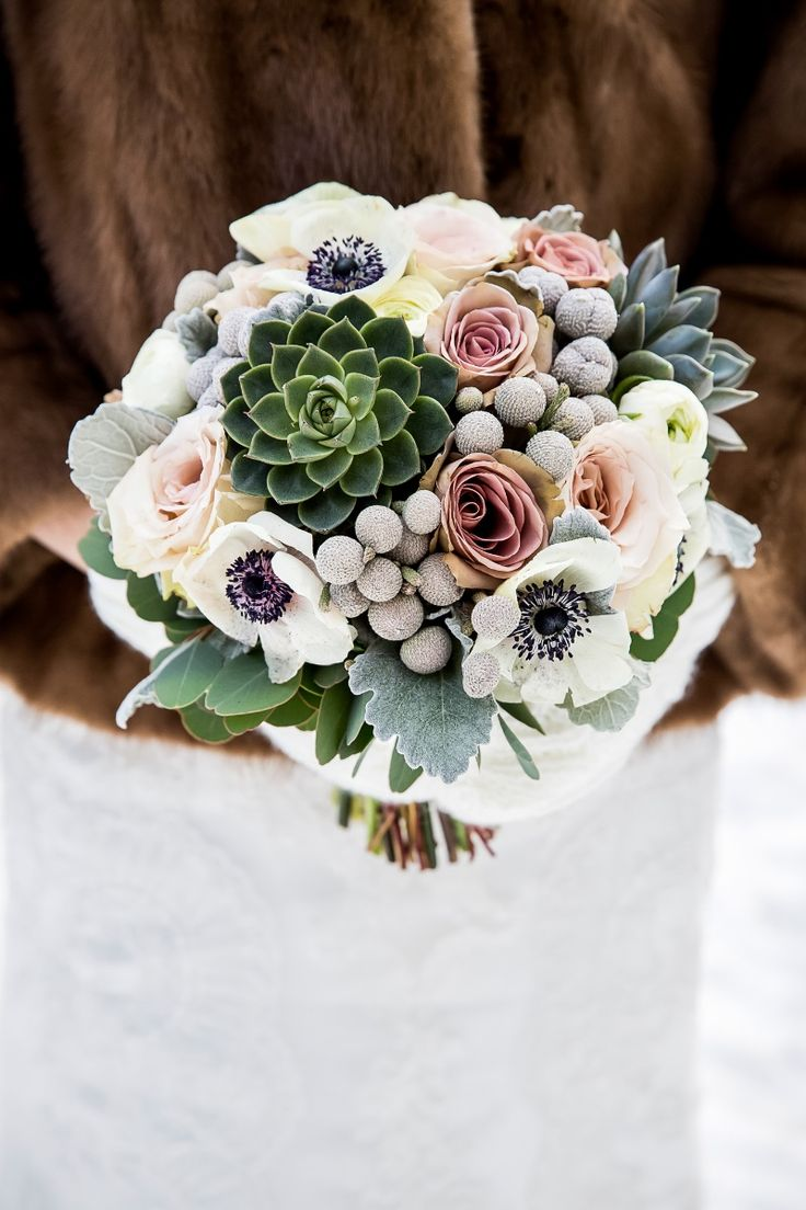 Beautiful winter bouquet with succulents and anemones created by @willowflowercoin Canmore, Alberta Photo by: @kimpayantphotography See more here: http://www.kimpayantphotography.com